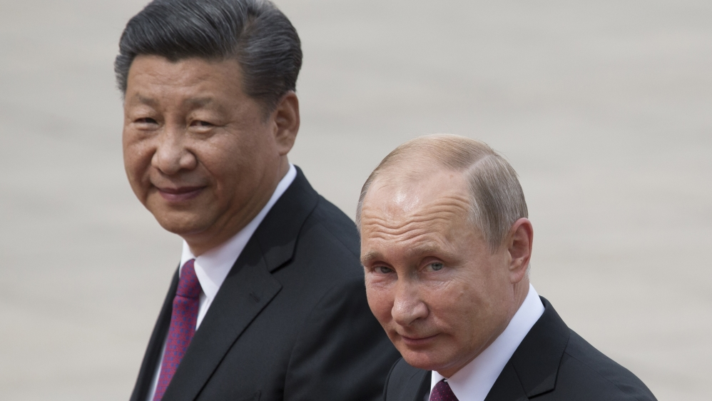 Russian President Vladimir Putin, right, and Chinese President Xi Jinping