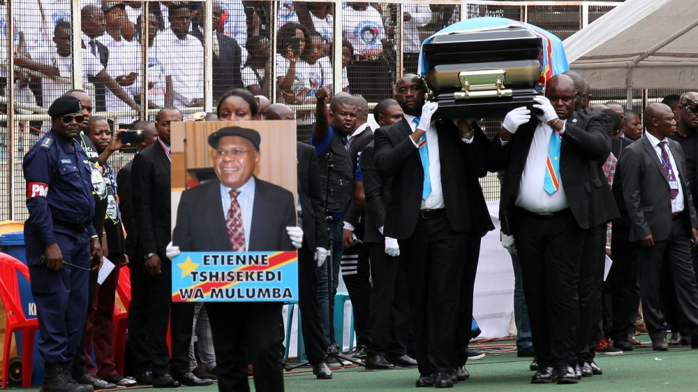 Pallbearers carry the casket with the remains of Etienne Tshisekedi, former Congolese opposition figurehead