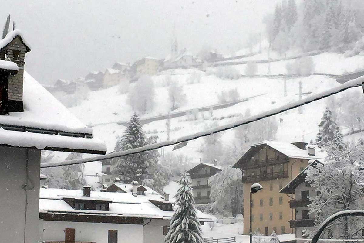Fresh snow covers the village of Falcade in the Dolomites, northern Italy. [Antonella Schena/EPA-EFE]