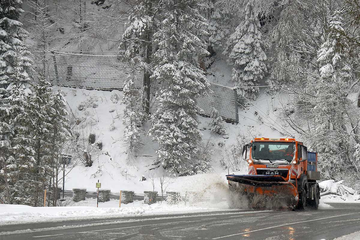 Roads needed to be cleared near Spitzingsee, after a late-spring snowfall in southern Germany. [Michael Dalder/Reuters]