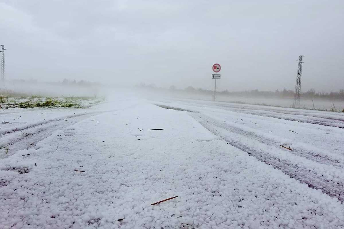 Hail fell to create what looked like a covering of snow in Bulgaria on the plain south of the Danube. [Antoaneta Vladimirova]