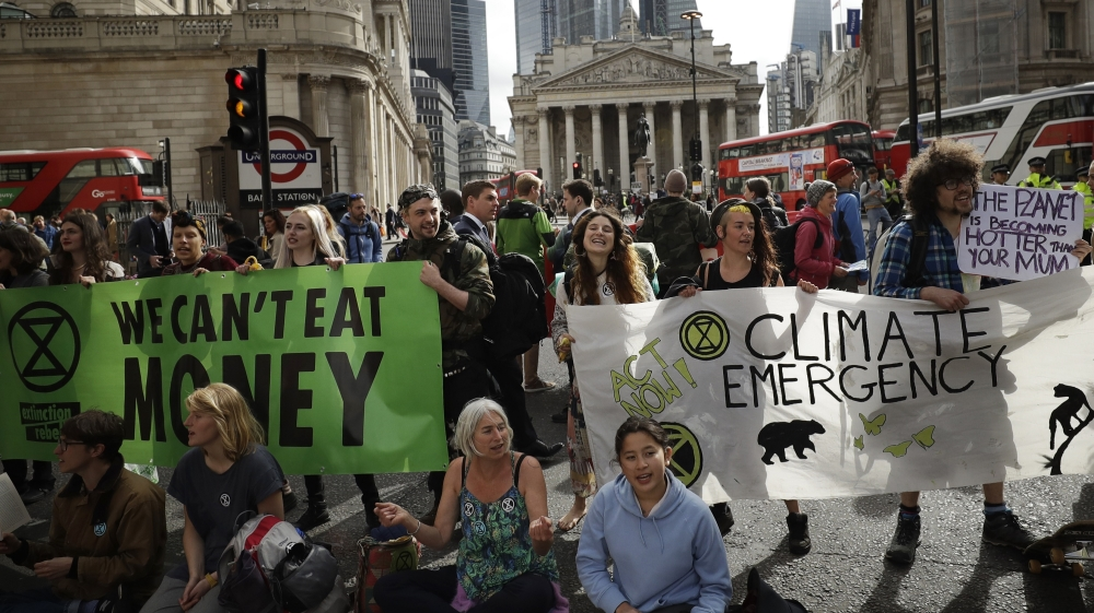 Extinction Rebellion climate change protesters block a road in central London, Thursday, April 25, 2019