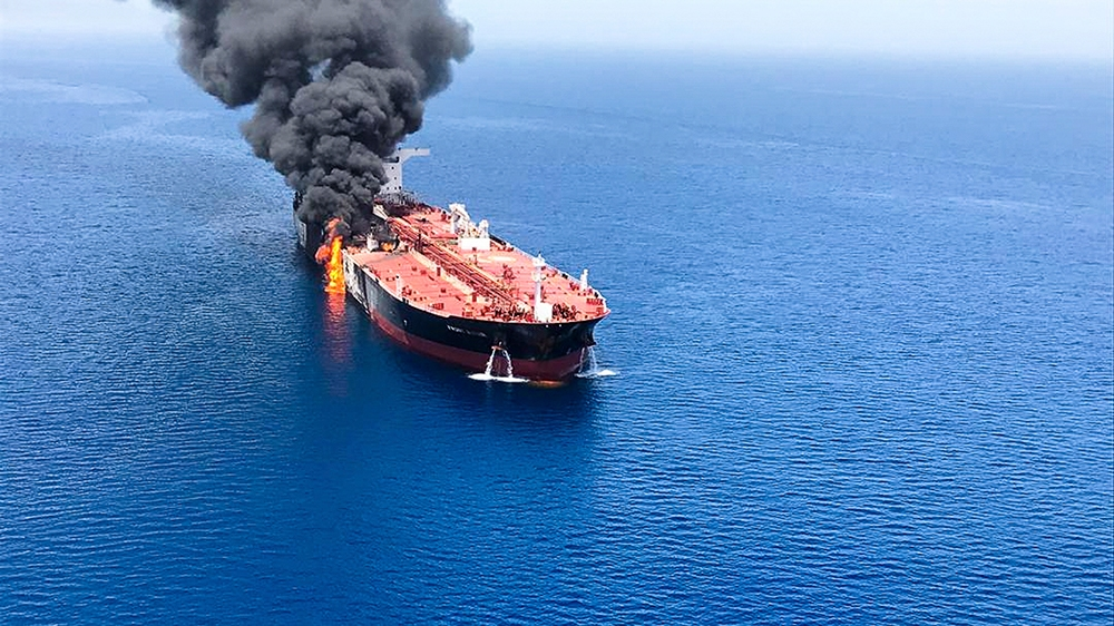 An oil tanker is on fire in the sea of Oman, Thursday, June 13, 2019. Two oil tankers near the strategic Strait of Hormuz were reportedly attacked on Thursday, an assault that left one ablaze and adri