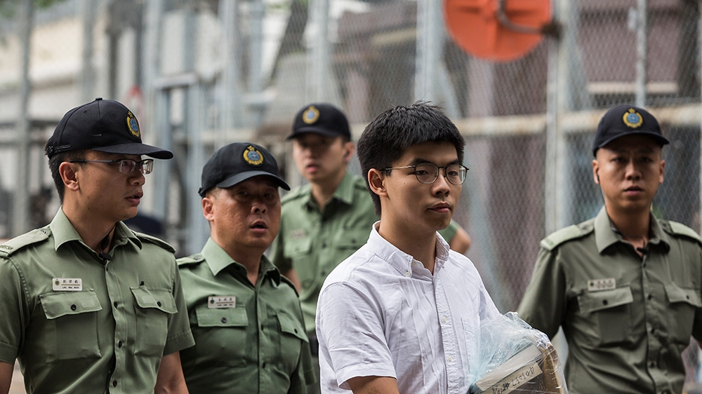 Hong Kong democracy activist Joshua Wong (C) leaves Lai Chi Kok Correctional Institute in Hong Kong on June 17, 2019. - Wong called on the city's pro-Beijing leader Carrie Lam to resign after he walke