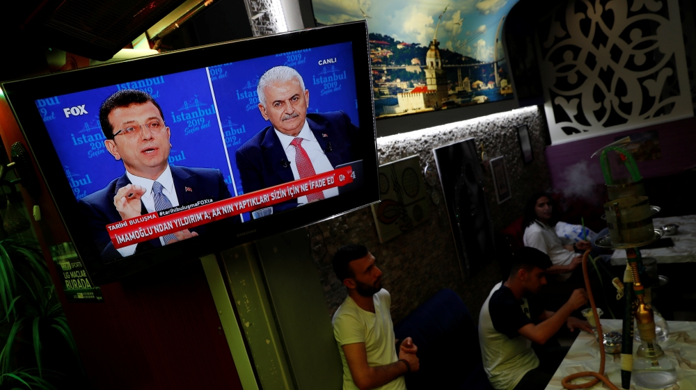 People watch and televised debate between Istanbul's mayoral candidates Imamoglu of CHP and Yildirim of AKP at a cafe in central Istanbul