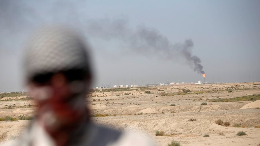 Excess gas is burnt off at the west Qurna 2 oilfield, during a protest in north Basra