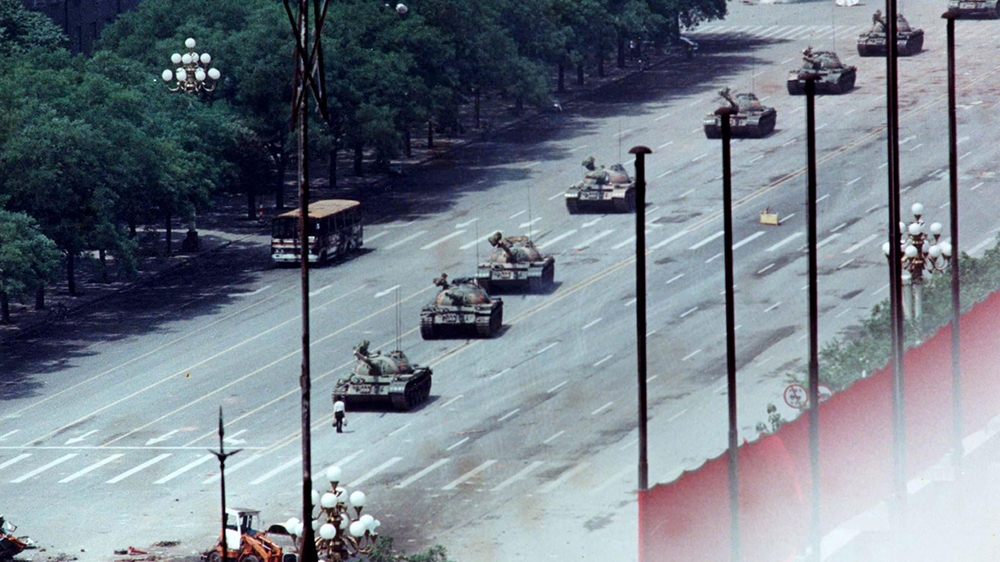 FILE PHOTO 5JUN89 - A Peking citizen stands passively in front of tanks on the Avenue of Eternal Peace in this June 5, 1989, file photo taken during the crushing of the Tiananmen Square uprising. The