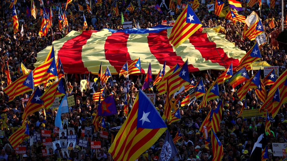People and Power - People take part in a rally of Catalan separatist organisations in Madrid