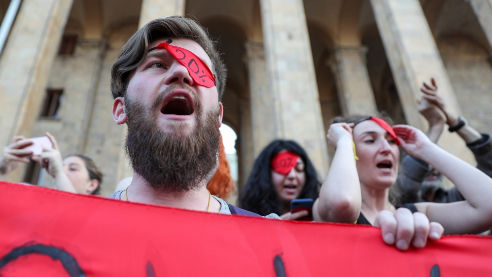 Protesters hold a rally against a Russian lawmaker's visit in Tbilisi