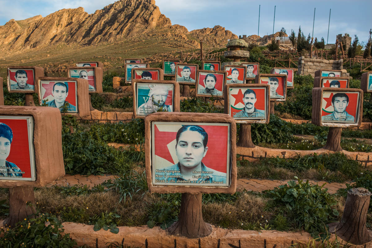 In the northern part of Mount Sinjar, near the city of Snooni, a grave of Yazidi male and female fighters of the Yazidi Protection Units killed during ISIL's occupation or in the battle against ISIL. [Alessio Mamo/Al Jazeera]