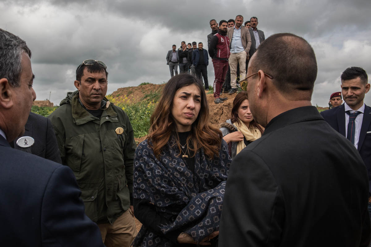 The Nobel Peace Prize laureate Nadia Murad marks the opening of the first mass grave in Kojo, Sinjar. [Alessio Mamo/Al Jazeera]