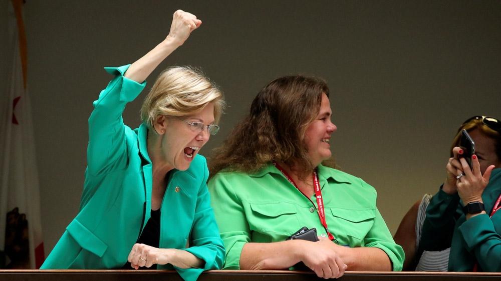 Warren raising fist