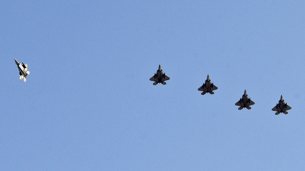 F-22 Raptors fly in formation as they prepare to land at Al Udeid Air Base, Qatar