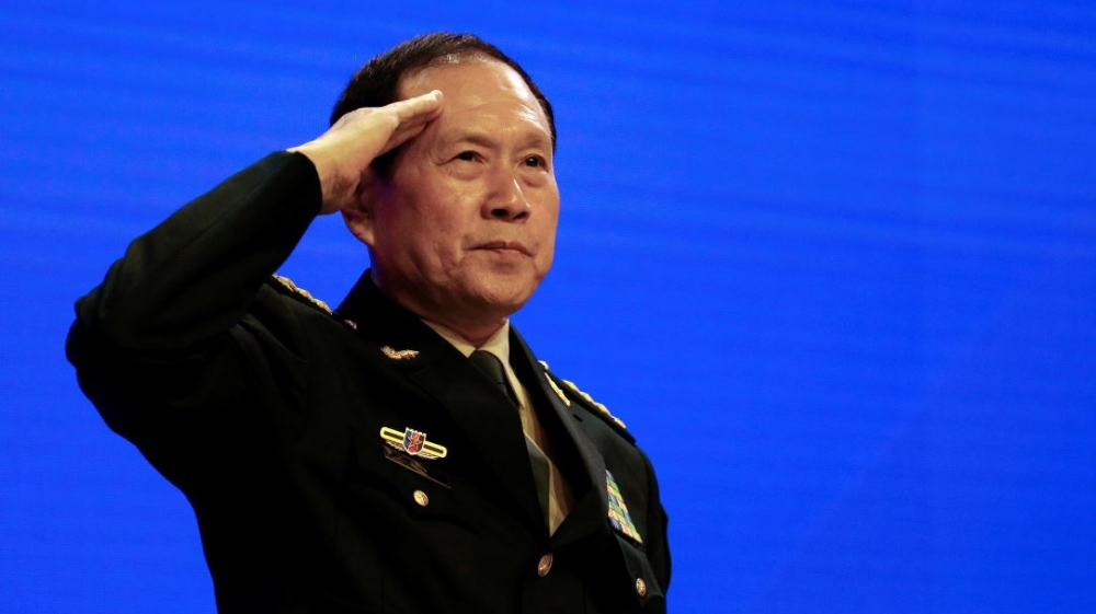 Chinese Defense Minister Wei Fenghe salutes at the IISS Shangri-la Dialogue in Singapore