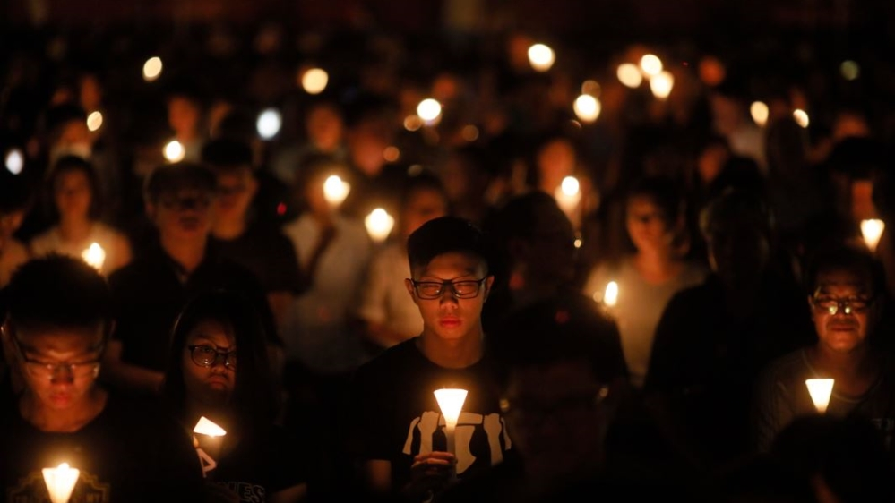 Tiananmen Square:  Tens of thousands attend an annual candlelight vigil at Hong Kong's Victoria Park
