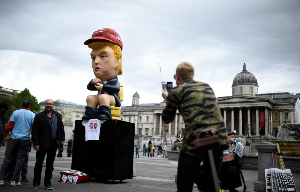 'Best President Ever' - Pro-Trump Activist Pops Baby Trump Balloon In UK