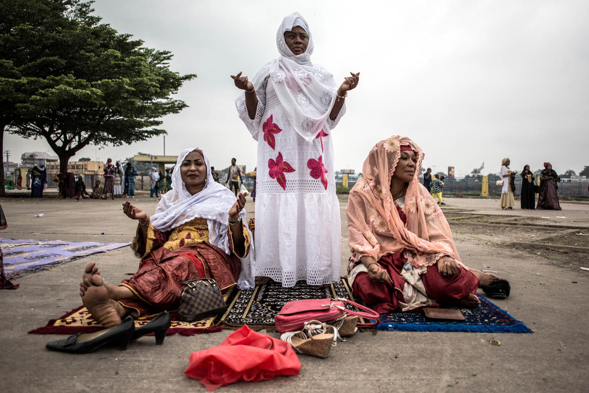 Muslim worshippers pray to celebrate Eid al-Fitr at the Stade des Martyrs in Kinshasa, Democratic Republic of the Congo. [John Wessels/AFP]