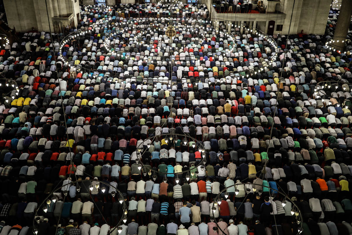 Turkey's Muslims offer prayers during the first day of Eid al-Fitr, which marks the end of the holy fasting month of Ramadan at the Suleymaniye Mosque in Istanbul, early Tuesday, June 4, 29. (AP Photo