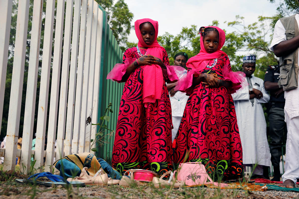 Muslims celebrate Eid al-Fitr with mass prayers marking the end of Ramadan in Abuja, Nigeria. [Afolabi Sotunde/Reuters]