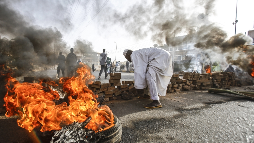 Sudanese protesters close Street 60 with burning tyres and pavers as military forces tried to disperse a sit-in outside Khartoum's army headquarters on June 3, 2019. At least two people were killed Mo