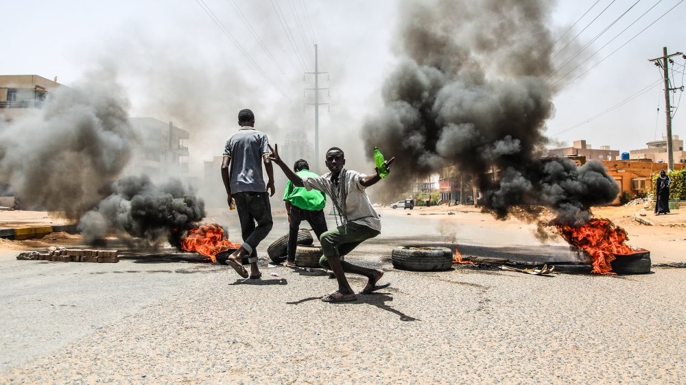 Demonstrations in Sudan- - KHARTOUM, SUDAN - JUNE 03 : Sudanese protesters burn tyres and set up barricades on roads to army headquarters after the intervention of Sudanese army, during a demonstratio