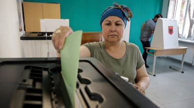 A woman casts a vote at a voting centre in Tirana, Albania June 30, 2019. REUTERS/Florion Goga