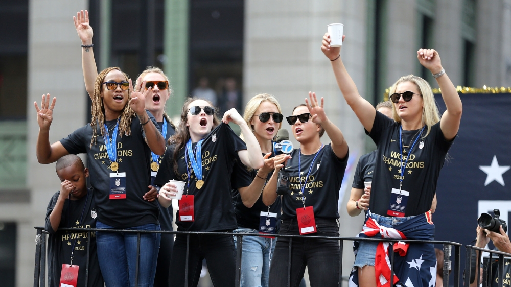 Members of the United States women's national team celebrate on a float during the ticker-tape parade for the United States women's national soccer team down the canyon of heroes in New York City. Ma