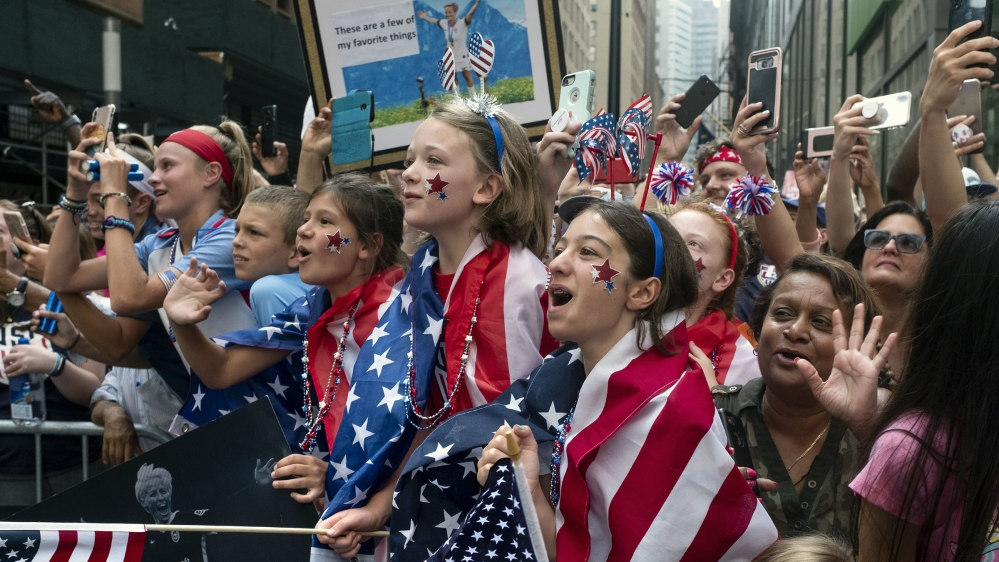 Fans celebrates as members of the the U.S. women's soccer team pass by during a ticker tape parade along the Canyon of Heroes, Wednesday, July 10, 2019, in New York. The U.S. national team beat the Ne