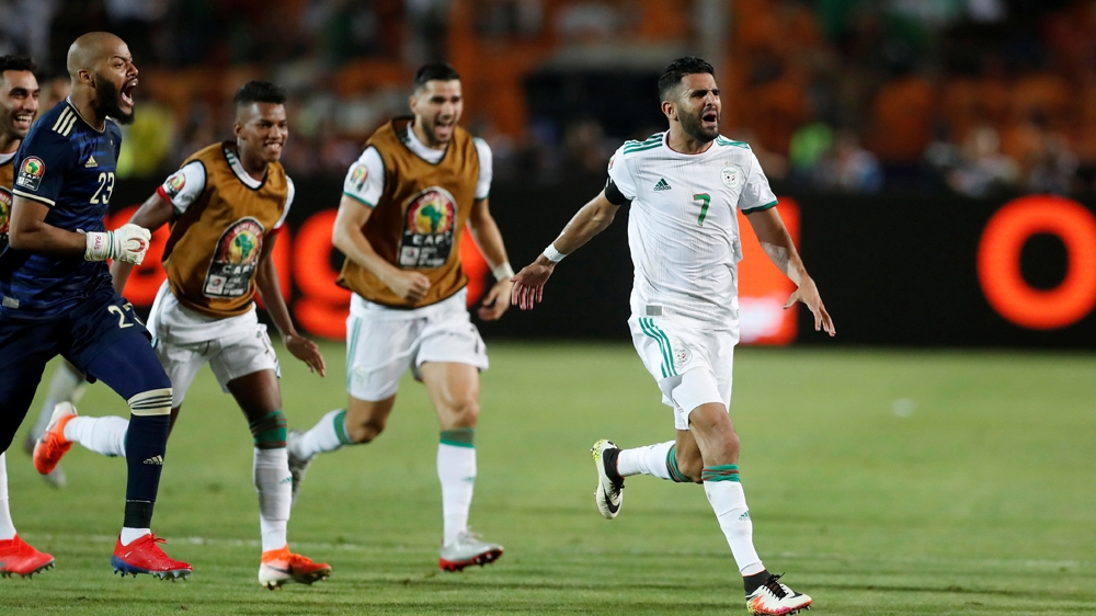 Soccer Football - Africa Cup of Nations 2019 - Semi Final - Algeria v Nigeria - Cairo International Stadium, Cairo, Egypt - July 14, 2019 Algeria's Riyad Mahrez celebrates scoring their second goal wi