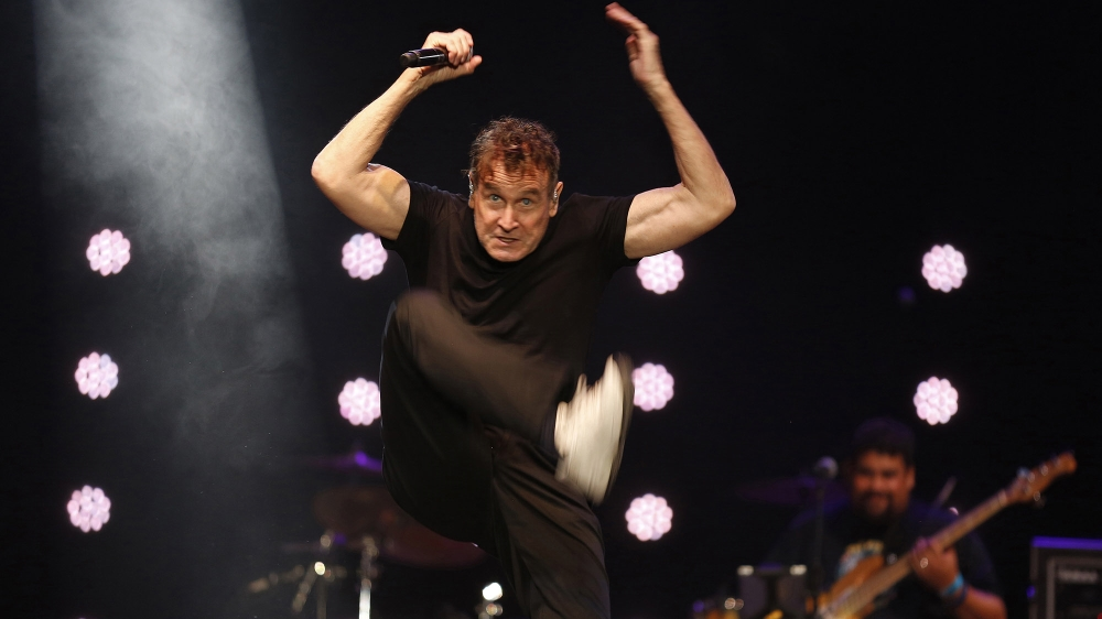musician Johnny Clegg performs on stage during his own farewell concert in Johannesburg. Clegg died at his home in Johannesburg Tuesday, July 16, 2019 after suffering from pancreatic cancer. (AP Photo