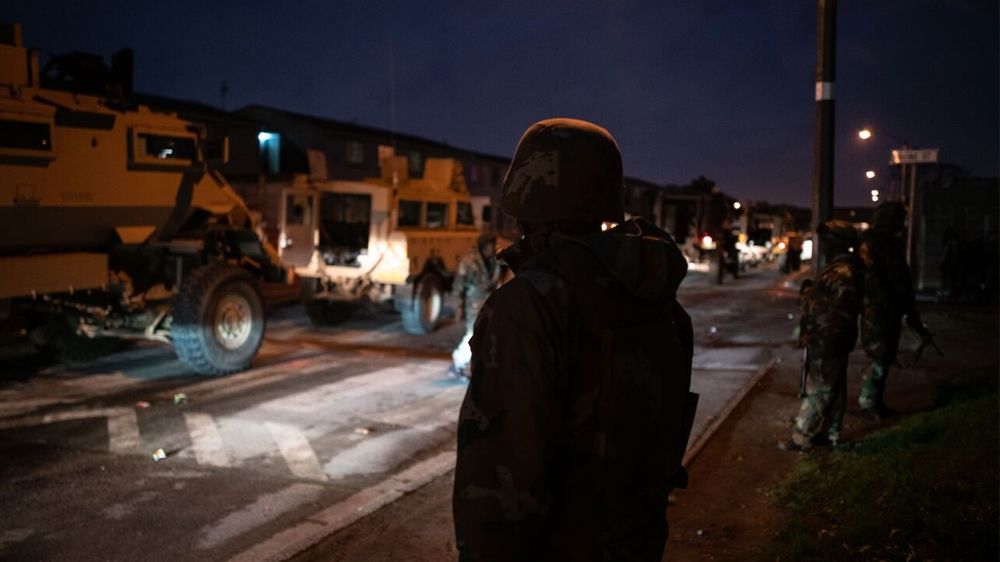 Armoured vehicles in Manenberg, a  heavily gang-afflicted area on the Cape Flats [Shaun Swingler/Al Jazeera]