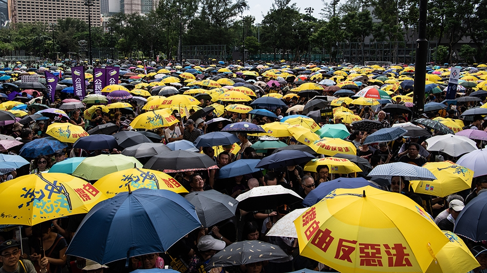 Protesters gather at Victoria Park to participate in an anti-government march in Hong Kong on July 21, 2019. - Hong Kong is bracing for another huge anti-government march on July 21 afternoon with see