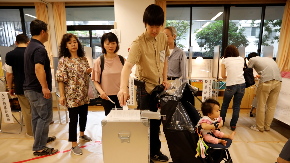 Voting underway in Japan's upper house election; 370 candidates in fray