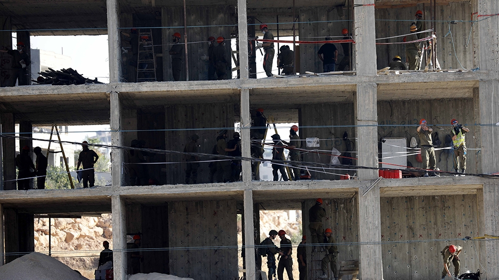 Israeli army troops deployed explosives in a building in the Palestinian village of Sur Baher in East Jerusalem on July 22, 2019. Israeli authorities decided to demolish at least six Palestinian homes