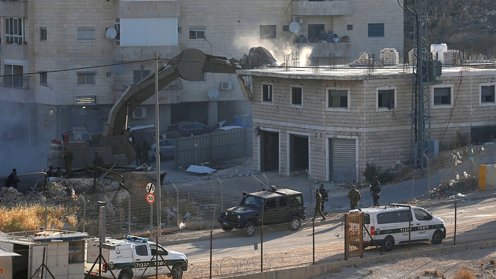 An Israeli machinery destroys a Palestinian building in the village of Sur Baher, located on both sides of the Israeli Barrier in East Jerusalem and the Israeli occupied West Bank. July 22, 2019.