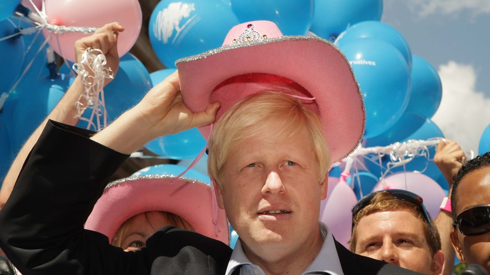 London Mayor Boris Johnson wears a pink stetson hat at the Gay Pride parade on July 5, 2008 in London, England. The parade consists of celebrities, floats, and performers celebrating the UK's largest