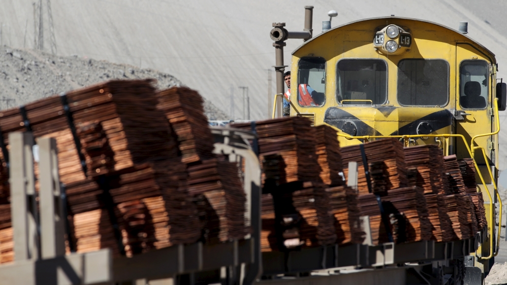 A train loaded with copper cathodes travels along a rail line inside the Chuquicamata copper mine, which is owned by Chile's state-run copper producer Codelco