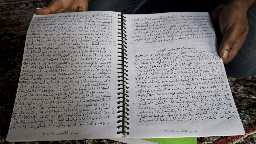 The picture of handwritten Quran by Ali Muhammad Bhat in jail.