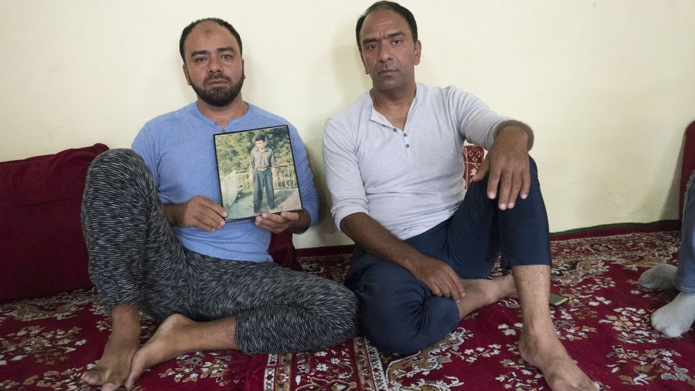 Mirza Nissar Hussain showing his picture of teenage at his home in Srinagar after the was released from an Indian jail where he spent 23 years in connection with multiple blast cases that took place i