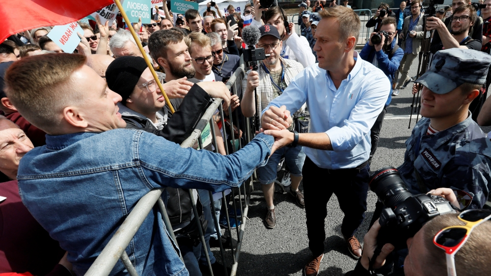 Russian opposition leader Alexei Navalny welcomes protesters during a rally in Moscow.