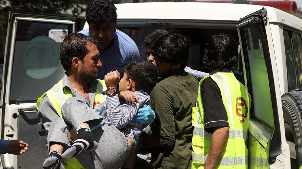 An Afghan health worker carries a wounded school student after a car bomb blast targeted a governmental institution in downtown Kabul, Afghanistan, 01 July 2019. According to reports, dozens of people