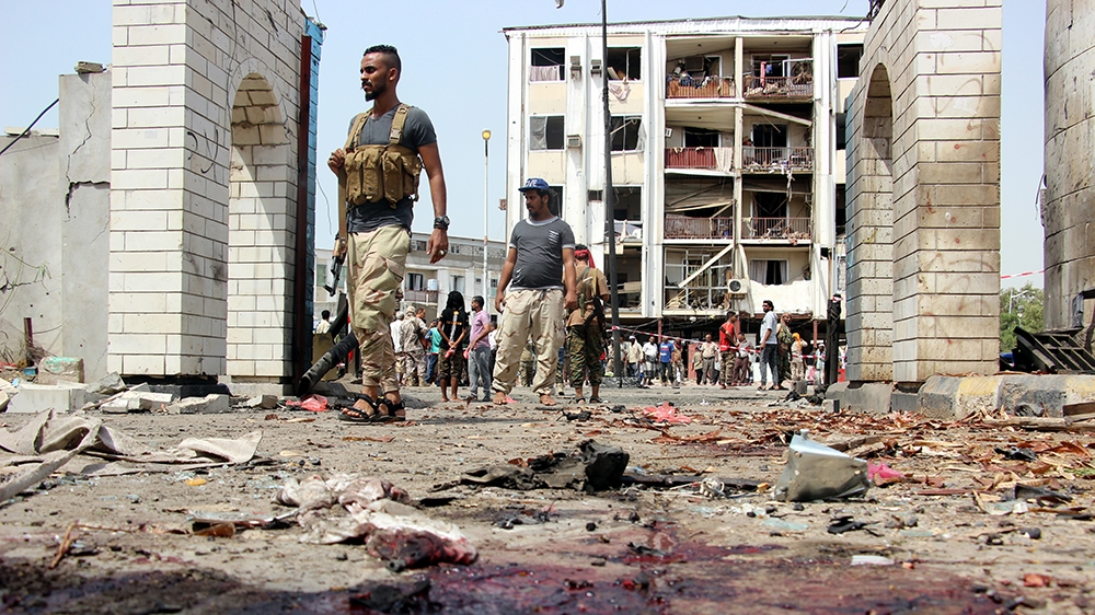 Yemeni soldiers inspect the site of a car bomb attack that targeted a police station in the southern port city of Aden, Yemen, 01 August 2019. According to reports, at least 40 security personnel and
