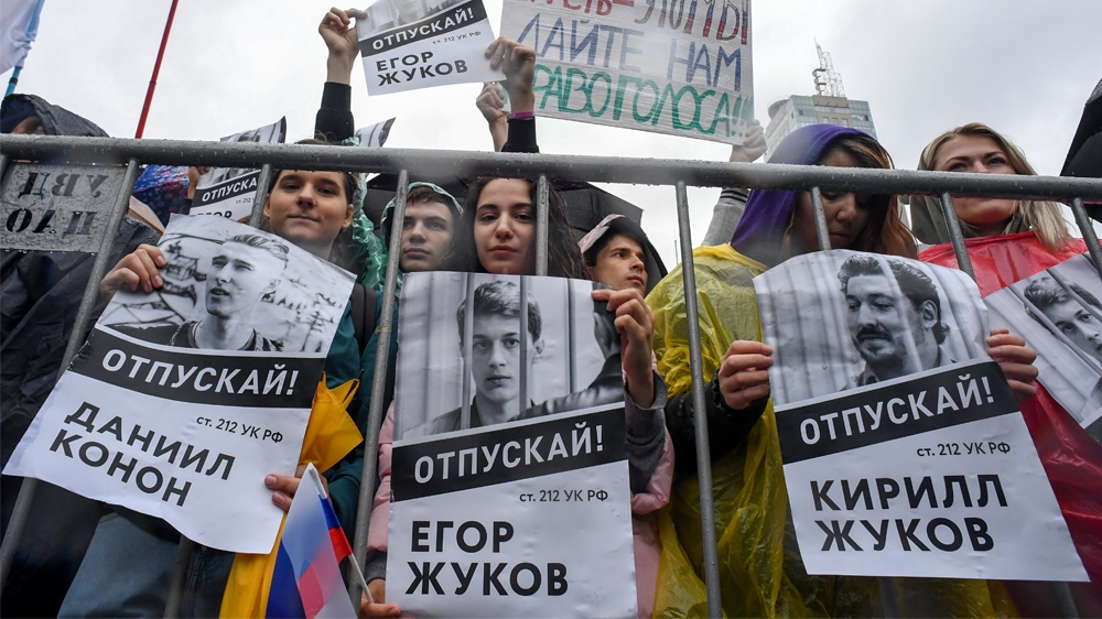 RUSSIA-POLITICS-DEMONSTRATION-VOTE  Protesters holds a poster reading