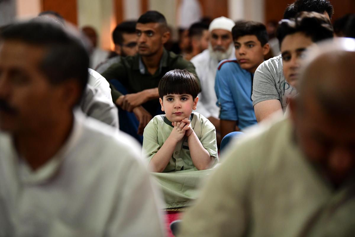 Iraqis pray during the festival of Eid al-Adha at Um Al-Tabool mosque in central Baghdad [Murtaja Lateef/EPA]