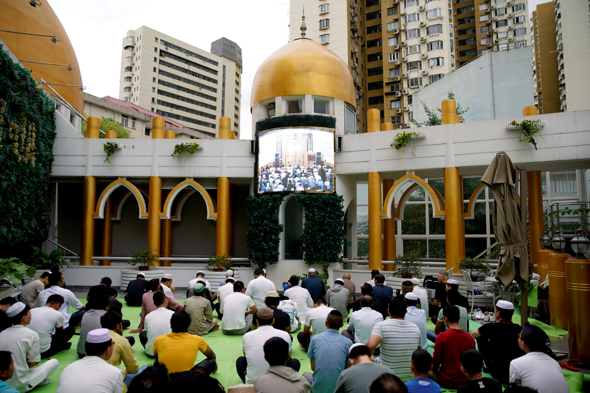 Muslims offer Eid al-Adha prayers at a mosque in Shanghai, China [Aly Song/Reuters]