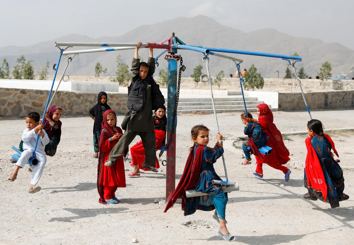 Afghan children celebrate the first day of the Muslim holiday of Eid al-Adha, in Kabul [Mohammad Ismail/Reuters]