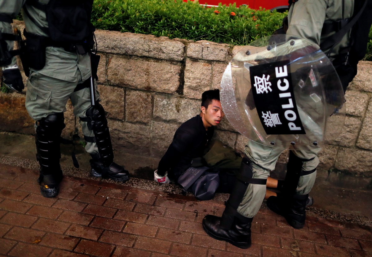 Police have arrested more than 600 people since the unrest began more than two months ago. [Issei Kato/Reuters]