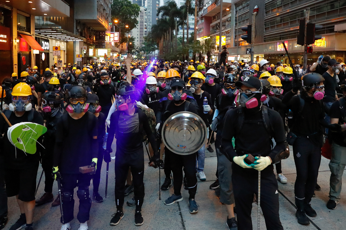 The protests began in opposition to a bill allowing the extradition of Hong Kong nationals to the mainland to stand trial, but have widened to highlight other grievances. [Vincent Thian/AP Photo]
