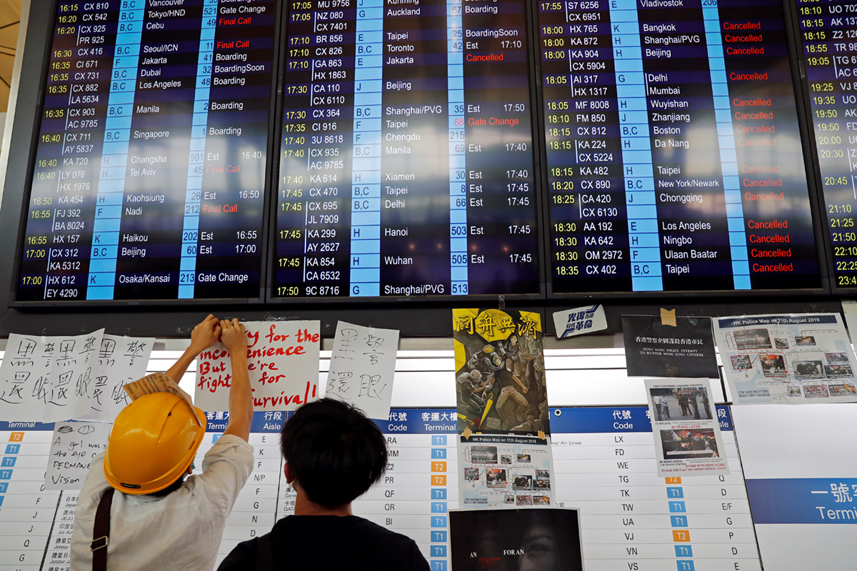 All flights in and out of Hong Kong were cancelled on Monday. [Tyrone Siu/Reuters]