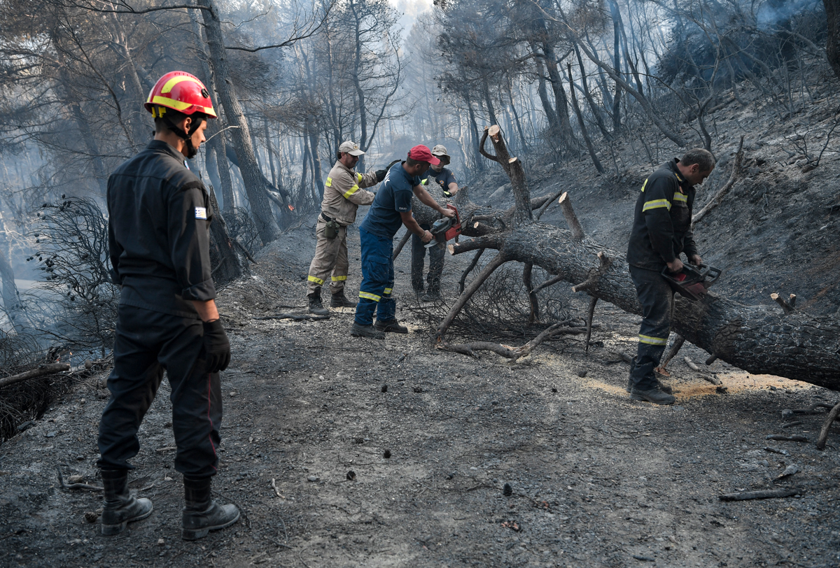 'Conditions are exceptionally difficult and the state's first priority is to protect lives,' said Greek Prime Minister Kyriakos Mitsotakis. [Louisa Gouliamaki/AFP]